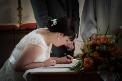 Bride signing register Lincolnshire Wedding Photographer