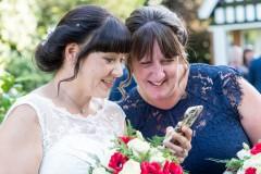 bride looking at mobile phone