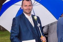 wedding guest with umbrella