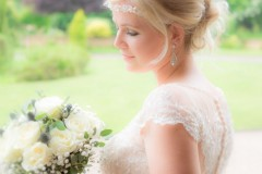 bride looking at flowers