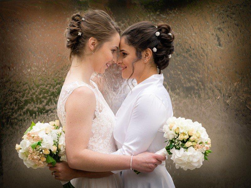 two brides hugging LGBT