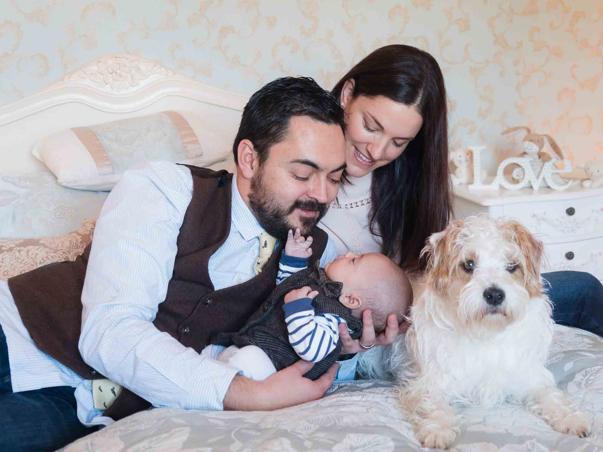 family portrait with baby and dog