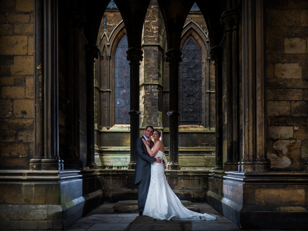 bride and groom at lincoln cathedral