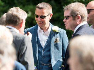 group of men talking at wedding